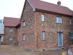 Quantock rubble stonework and brick quoining
