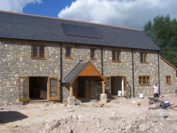 Helland, Somerset. Rebuild of old farmhouse. Using new and existing stone.